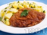 Виенски шницел от свинско каре (контра филе) паниран в брашно, галета и яйца на тиган